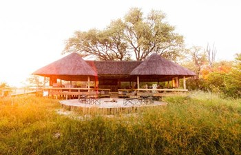 sun shining over the main guest area and lounge at The Jackal & Hide in the Khwai Area of Botswana
