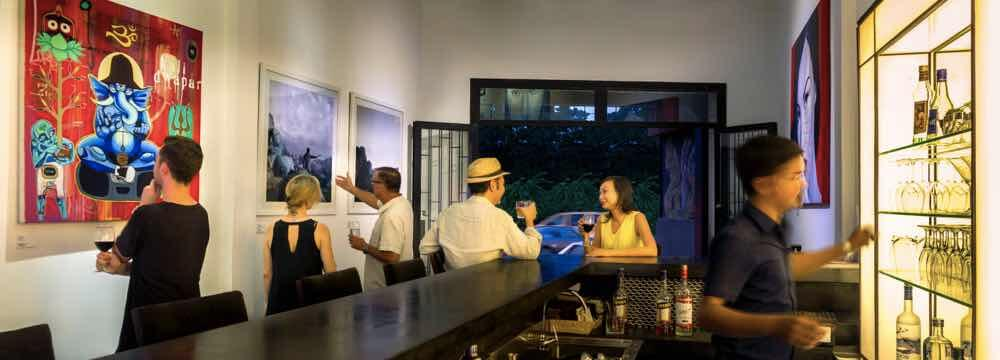 Guests enjoy an exhibition at the One Eleven Gallery in Siem Reap